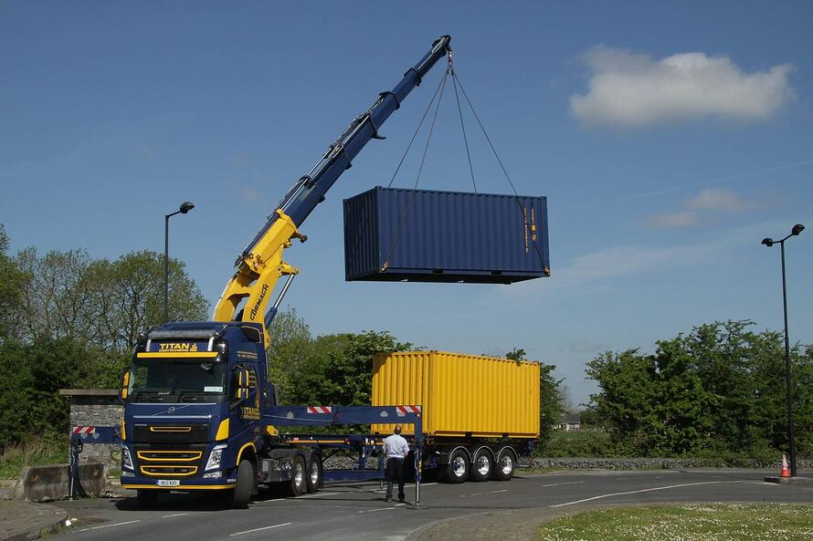 titan containers delievery container in the air lift